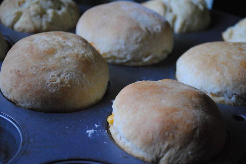 stuffed biscuits in a muffin tin