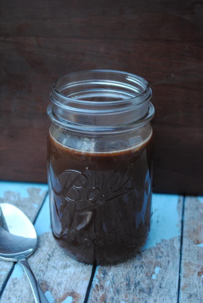 Homemade chocolate syrup in a jar