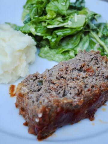 Classic Italian meatloaf with mashed potatoes and salad