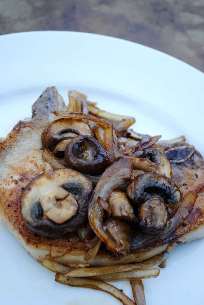 Pork chops smothered with onions and mushrooms. Simple meal, big on flavor.