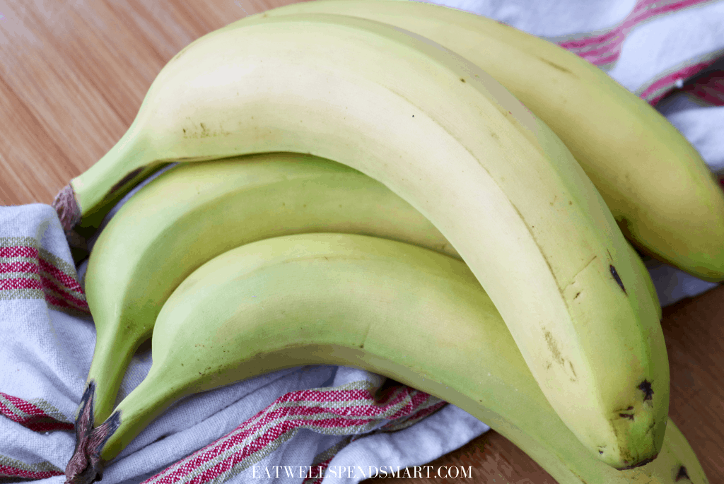 Bunch of bananas on a striped towel