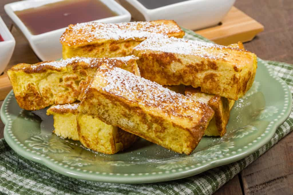 French toast sticks on a green plate