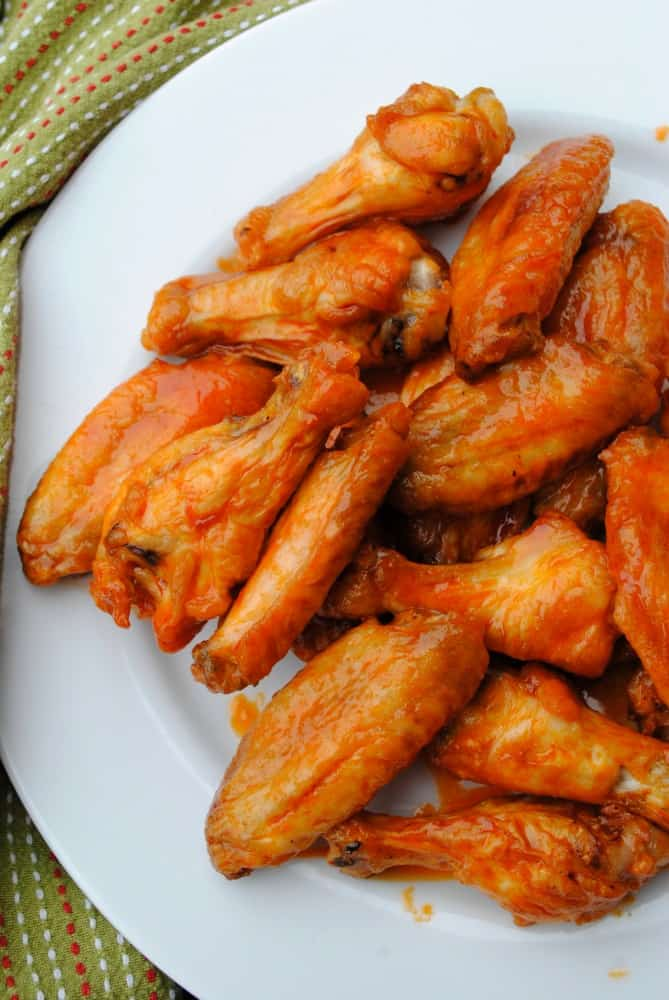 baked buffalo wings on a white plate