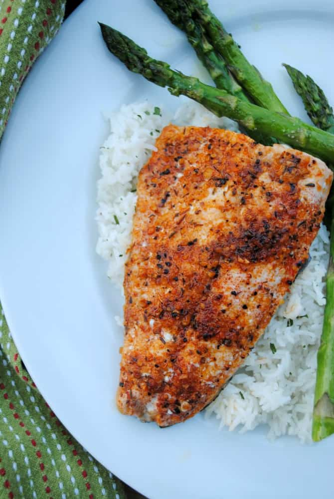 Cajun broiled salmon on a bed of rice with asparagus on the side