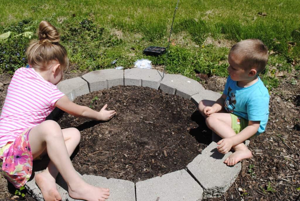 Children planting a garden