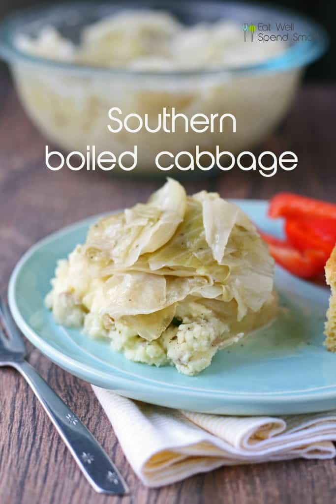 boiled cabbage on top of mashed potatoes and a light blue plate