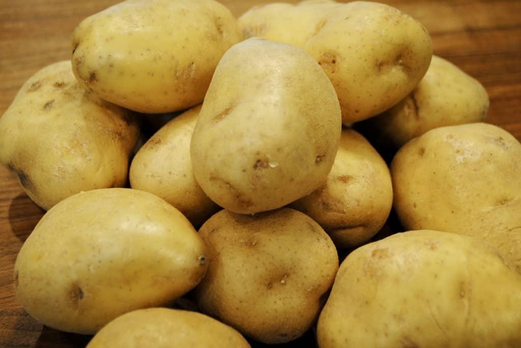 potatoes on a cutting board