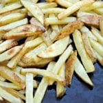 Crispy oven fries on a baking stone