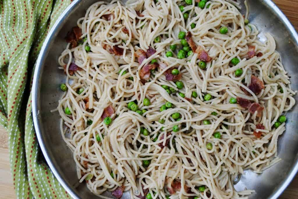 Pasta with bacon and peas. A super cheap and delicious family meal.