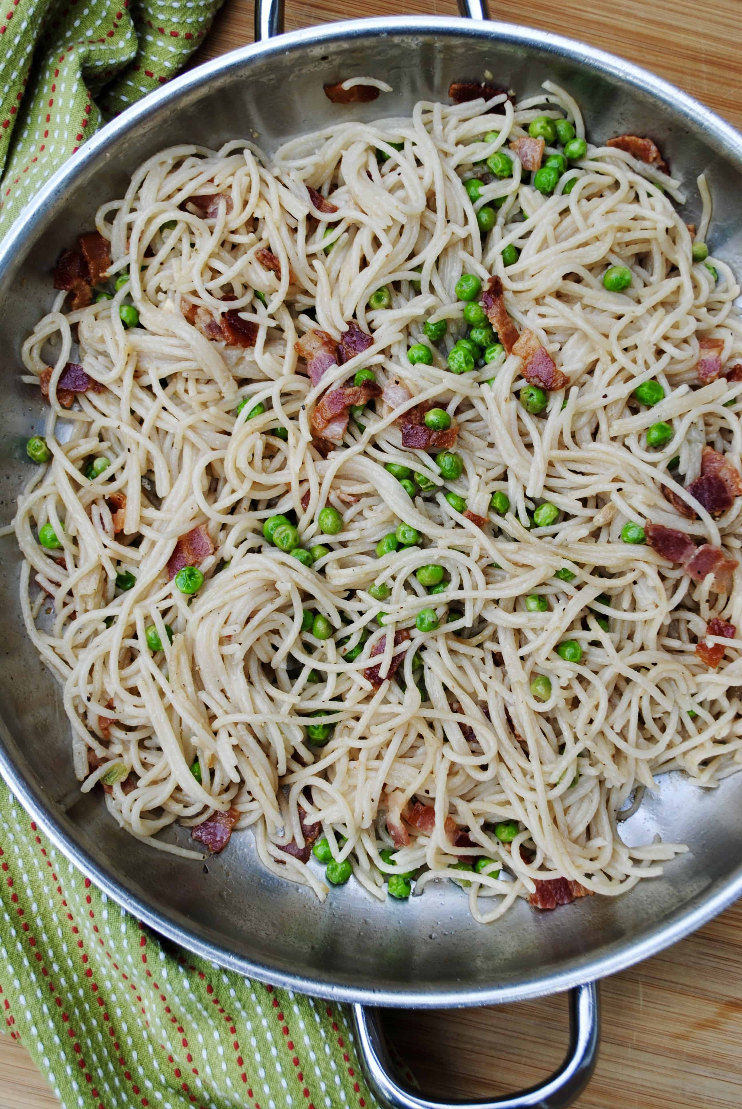 Pasta with bacon and peas. A simple inexpensive meal.
