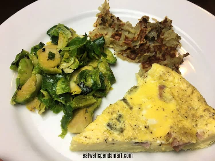 Egg bake, Brussels sprouts, and hashbrowns on a white plate