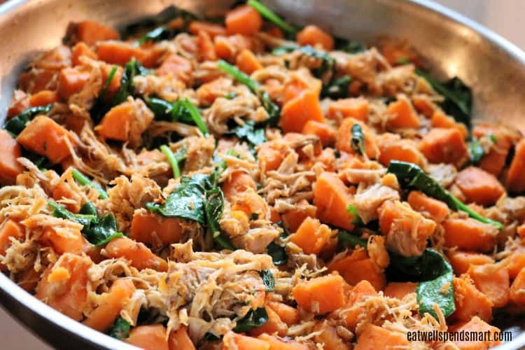 shredded pork, sweet potatoes, and spinach in a stainless skillet
