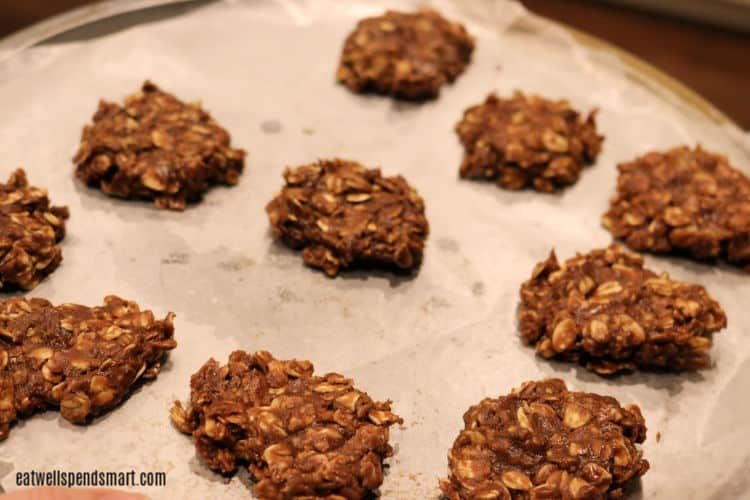 chocolate oat no-bake cookies on a parchment lined sheet pan