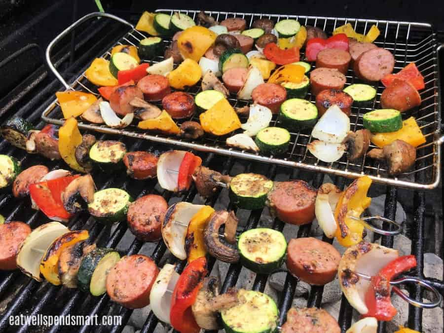 Smoked sausage and vegetable kabobs on the grill.
