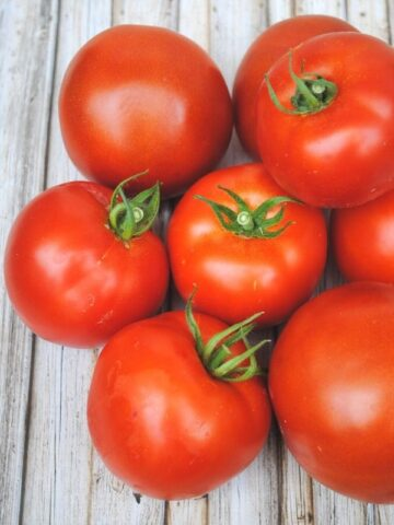 ripe tomatoes on a wooden backdrop