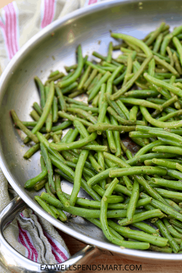 Cooked frozen green beans in a skillet