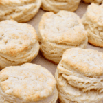 Homemade biscuits on a baking sheet