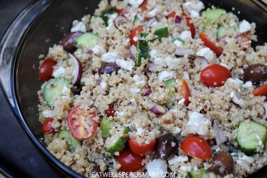 Greek quinoa salad. Quinoa, tomatoes, red onion, olives, cucumber, feta, and Greek dressing