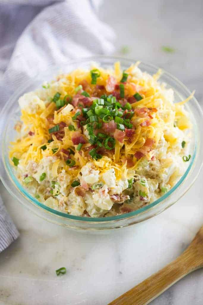 baked potato salad in a glass bowl